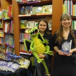 Angela James with Nadia, the first young lady of the day to buy a copy of 'The Golden Moonbeam'